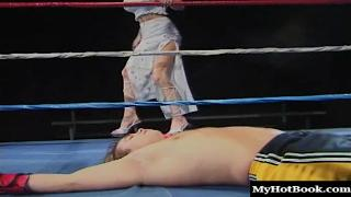 Alysin Embers is in her lingerie in a boxing ring with a boxer.